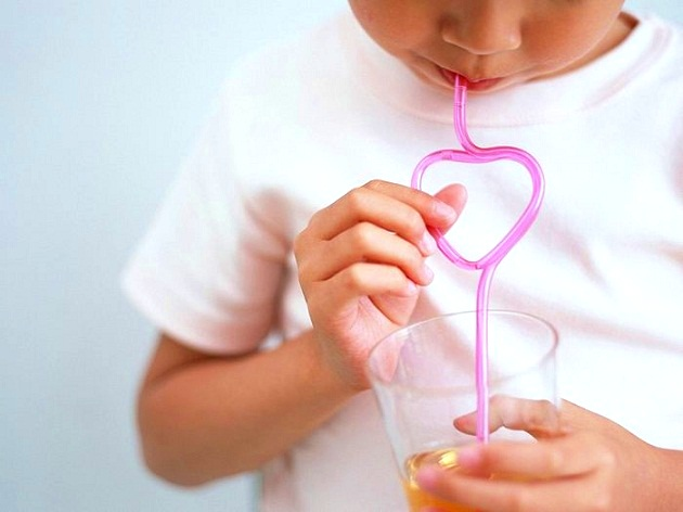 child with a straw